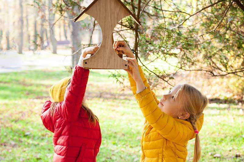 Girls Feeding Birds