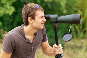 Man Using A Spotting Scope